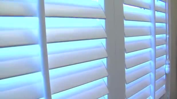 Thief Gets Stuck in Blinds While Escaping