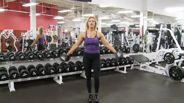 How to Do Standing Shoulder Press - Women's Fitness