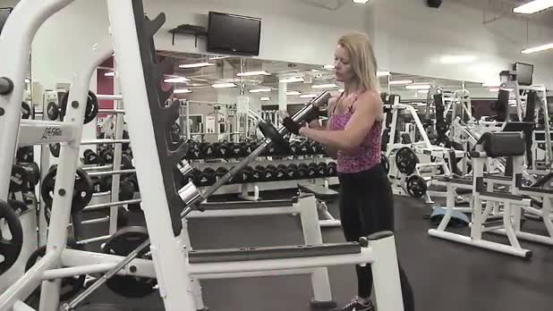 Squats with Vertical Barbell - Women's Fitness