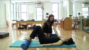 Pilates Bridge on the Roller - Women's Fitness