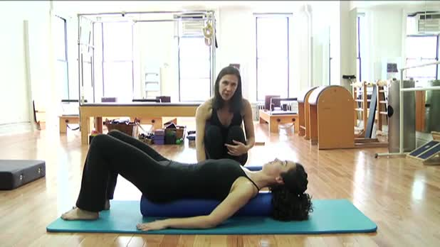 Pilates Knee Folds on the Roller - Women's Fitness