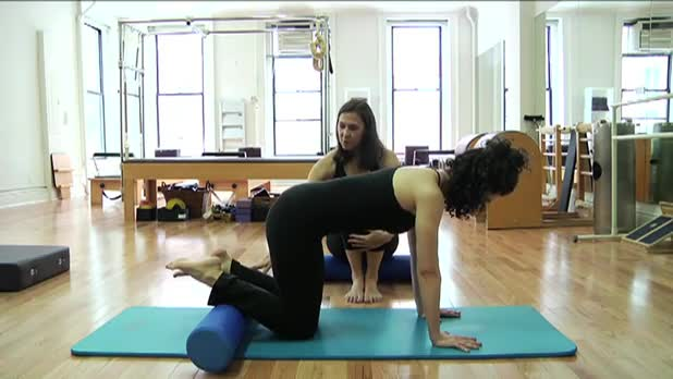 Pilates Knee Stretches on the Roller - Women's Fitness