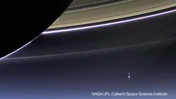 NASA's Cassini Captures Earth and Moon as Two Tiny Dots
