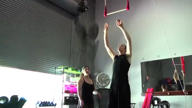 Circus Exercises: Tuck on the Trapeze - Women's Fitness